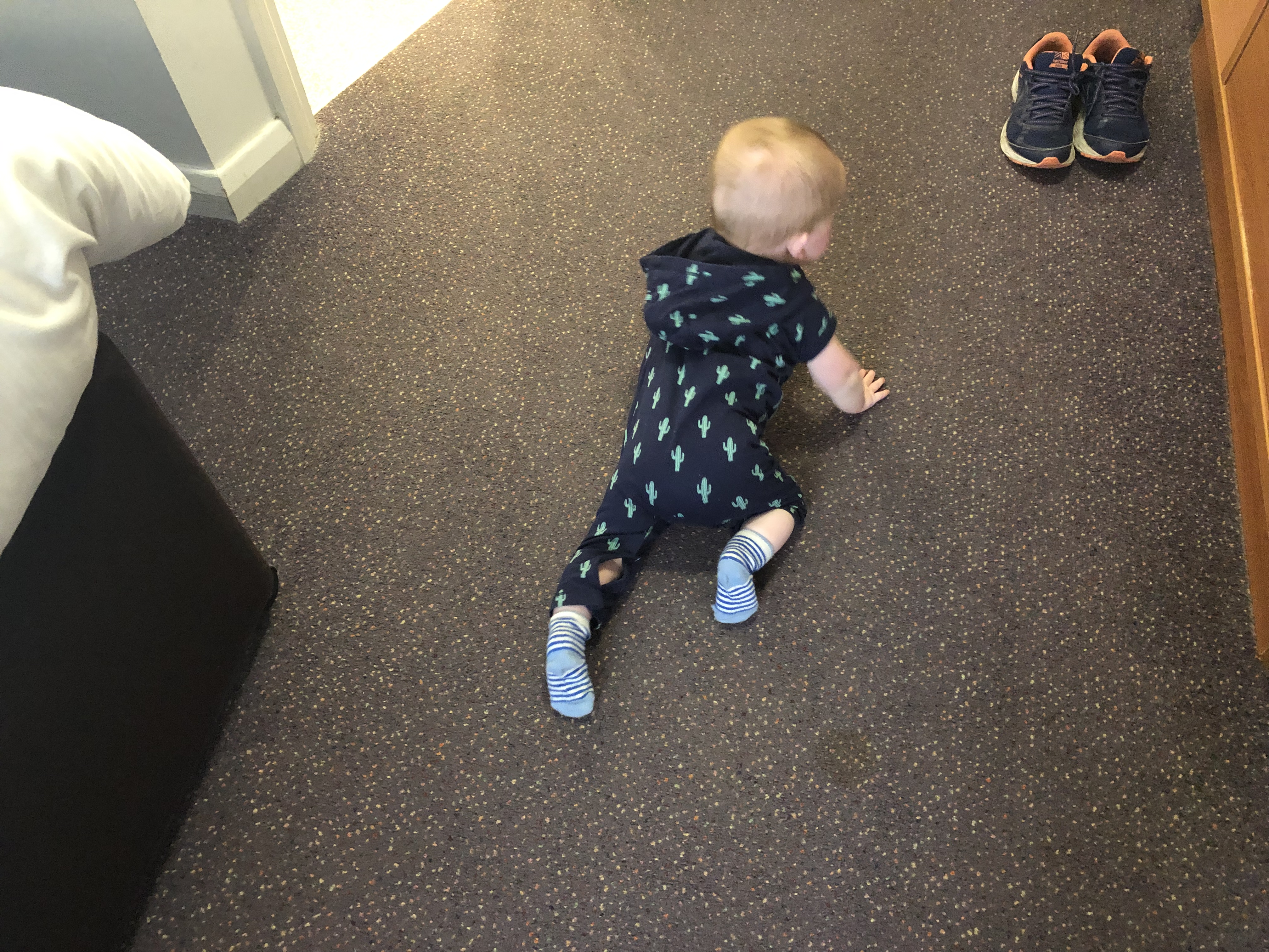 baby boy felix crawling in family room at premier inn weymouth seafront