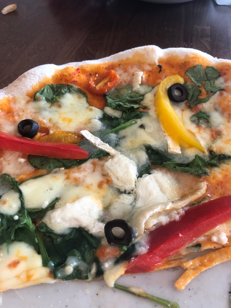 veggie pizza with goats cheese and peppers