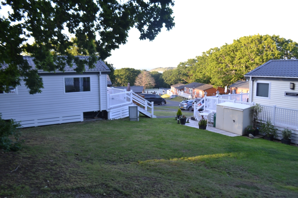 A picture of Thorness Bay caravan park with the private bay and Solent sea in the distance.