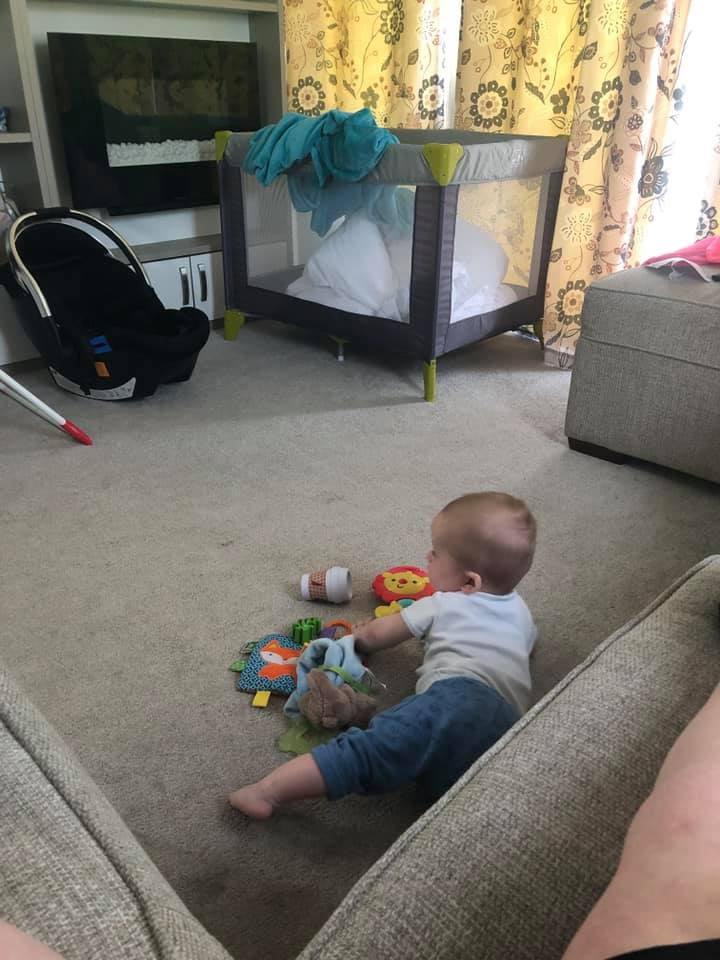 Thorness Bay Starboard Caravan Living room with Baby Felix playing with his toys
